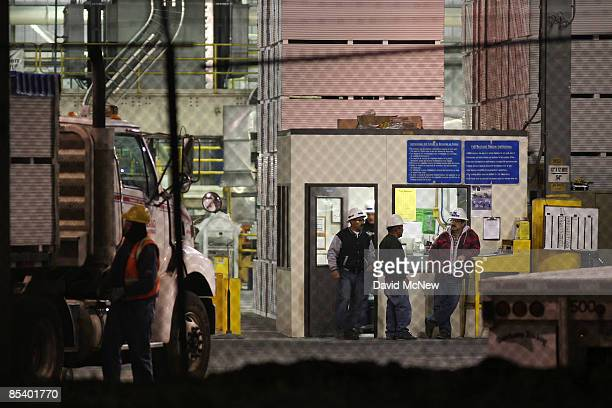 Work continues before dawn at the US Gypsum dry wall board plant which had to lay off workers once kept busy by the housing boom on March 12 2009 at...