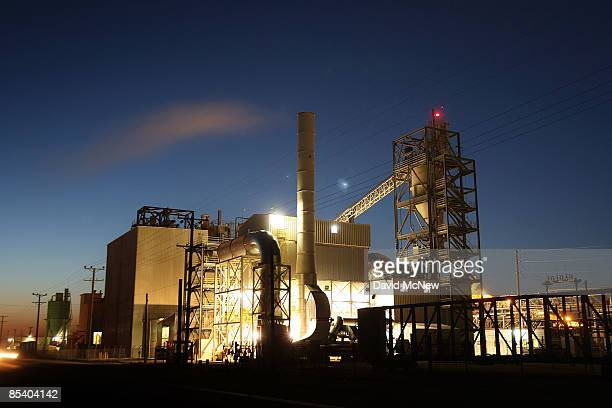 Work continues before dawn at the US Gypsum dry wall board plant which had to lay off workers once kept busy by the housing boom March 12 2009 at...