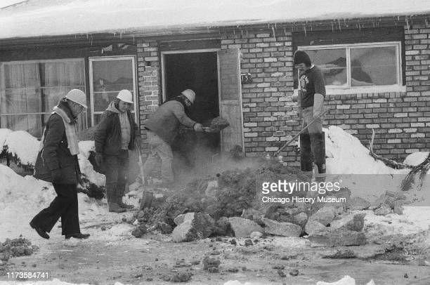 Work continues on removing mud from the crawl space where John Wayne Gacy buried his victims at 8213 West Summerdale Avenue Chicago Illinois January...