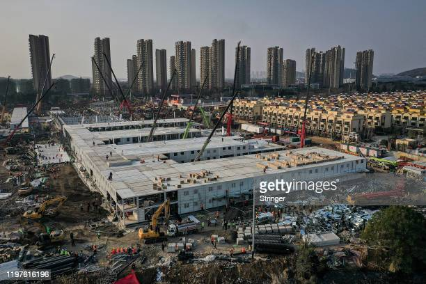 Work continues on Wuhan Huoshenshan hospital on January 30, 2020 in Wuhan, China. The 1000-bed hospital is scheduled to open on February 5. The...
