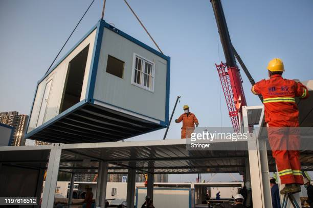 Work continues on Wuhan Huoshenshan hospital on January 30 2020 in Wuhan China The 1000bed hospital is scheduled to open on February 5 The number of...