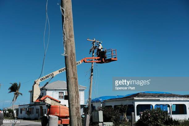 Work crew repairs power lines on the nearly destroyed island of Barbuda on December 8, 2017 in Cordington, Barbuda. Barbuda, which covers only 62...