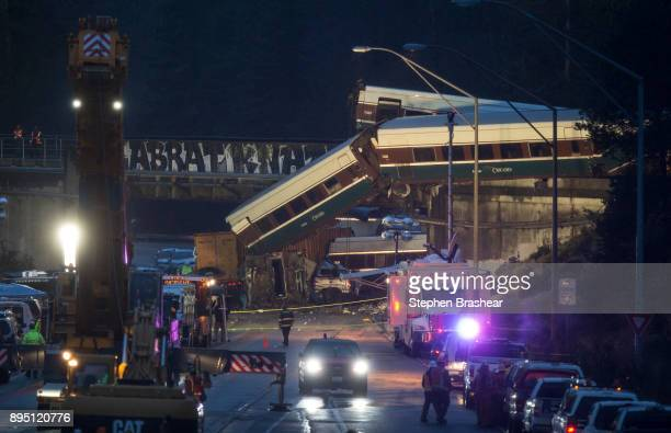 Work crews prepare to clear southbound I5 lanes at the scene of an Amtrak train derailment on December 18 2017 in DuPont Washington At least six...