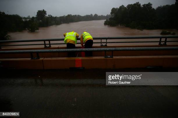 Work crews take measurements of the Brazos River as flooding continues throughout the greater Houston area
