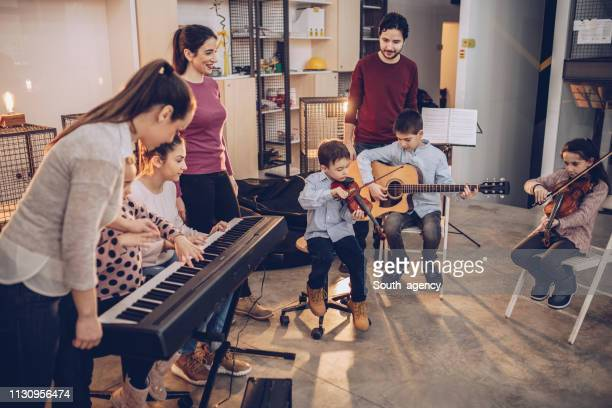 work day in kids music school - keyboard instrument stock photos and pictures