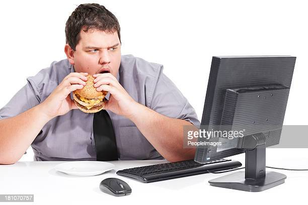 Fat Guy Eating Hamburger Stock Photos And Pictures