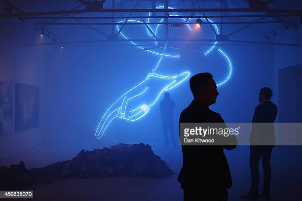 A work entitled 'The Blessing Hand' by artist Stepan Ryabchenko hangs during an exhibition of Ukrainian art at Saatchi Gallery on October 8 2014 in...