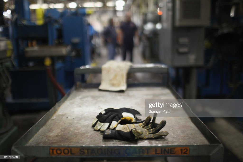 Work gloves are viewed on the factory floor at Quadrant, a high end plastic processor on October 19, 2011 in Reading, Pennsylvania. Quadrant, a 70 year old company, employs more than 2000 people in 20 countries and is one of the few remaining manufacturers in the area to still provide stable jobs in an uncertain economy. Reading, a city that once boasted numerous industries and the nation's largest railroad company, has recently been named America's poorest city with residents over 65,000. According to new census data, 41.3 percent of people live below the poverty line in Reading. Reading has about 90,000 residents, many of whom are recent Hispanic arrivals who have moved from larger eastern cities over the past decade. While a manufacturing base offering well paying jobs still exists in Reading, many companies like Hershey, Stanley Tool and Dana Systems have either moved elsewhere in the United States or to Mexico in search of cheaper labor. The number of people living in poverty in America, 46.2 million, is now at its highest level for the 52 years the Census Bureau has been keeping records.