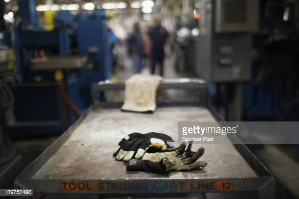 Work gloves are viewed on the factory floor at Quadrant a high end plastic processor on October 19 2011 in Reading Pennsylvania Quadrant a 70 year...