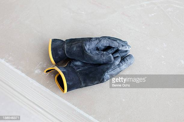 work gloves on top of each other - work glove stock photos and pictures