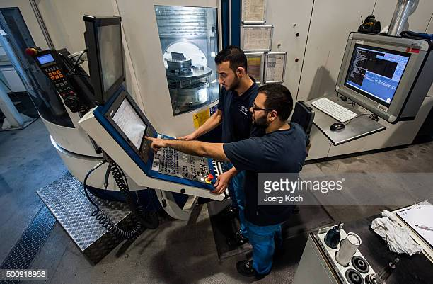 Work Here participant a refugee from Syria who came to Germany one year ago trains and works by instructions by machining operator Narinderbir Sagri...
