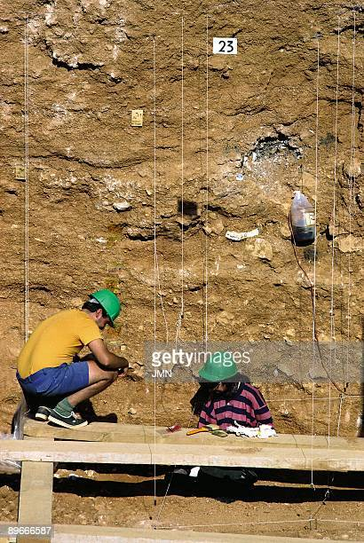 Work in a gallery in trench of the archaeological location of the Cave of IbeasAtapuerca A student and an archaeologist look for remains in a gallery...