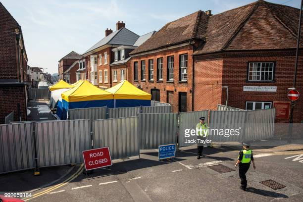 Work is carried out behind a police cordon in front of John Baker House Sanctuary Supported Living after a major incident was declared when a man and...