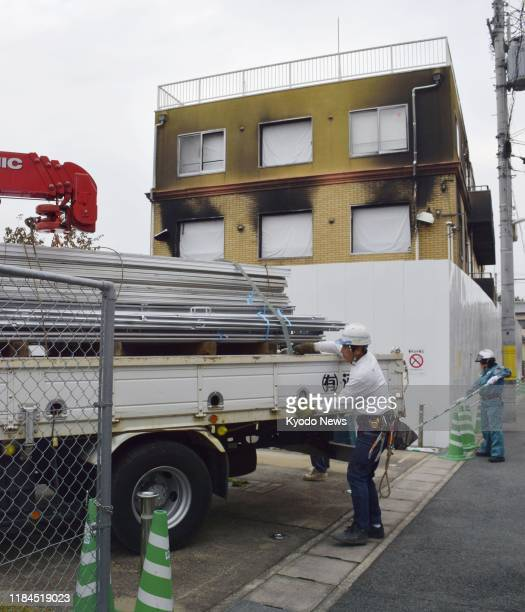 Work is under way to expand fences surrounding a Kyoto Animation Co. Studio in Kyoto on Nov. 25 ahead of demolition work. The studio was hit by an...