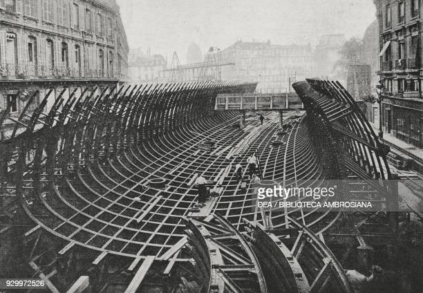 Work on the metro rail at Place Saint-Michel, Paris, France, photograph by Adolfo Croce, from L'Illustrazione Italiana, Year XXXIII, No 33, August...