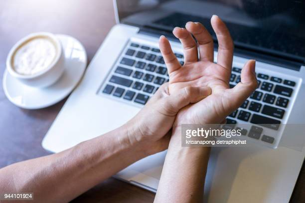 work on the notebook wrist pain,hand pain,wrist pain - wrist stock pictures, royalty-free photos & images
