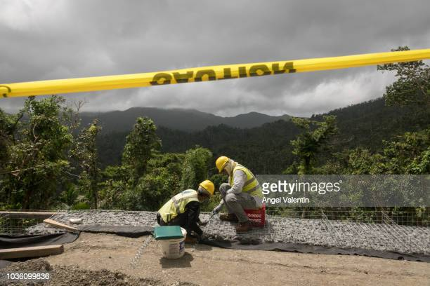 Work on the road to El Yunque Rain Forest on September 19 2018 in Rio Grande Puerto Rico Parts of the popular destination have been reopened while...