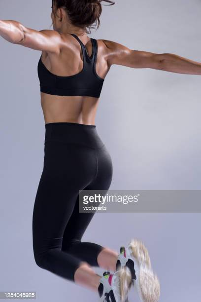 work out jump - woman bum stock pictures, royalty-free photos & images