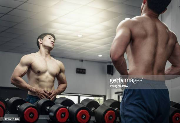 work out - asian six pack stock photos and pictures