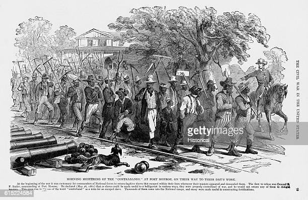 A work party composed of contrabands a term applied to fugative slaves muster for work at the Union controlled Fort Monroe Virginia during the...