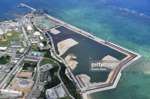 Work resumes in the Henoko coastal district of Nago, Okinawa Prefecture, southern Japan, on June 12 for the relocation of a key U.S. Military base...
