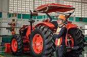 plow modern tech red tractor close