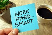 Work smart - motivational reminder handwritten on sticky note