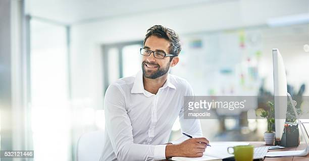 work smarter, not harder - man in office stock photos and pictures