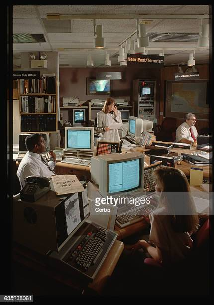 Work stations are arranged in a circle at the Central Intelligence Agency's operations center Intelligence specialists share items on a large lazy...