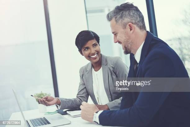 work together, win together - indian woman stock photos and pictures