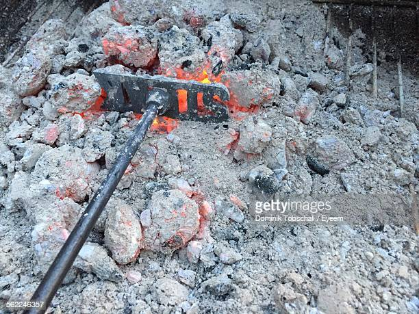 Work Tool On Ashes On Campfire