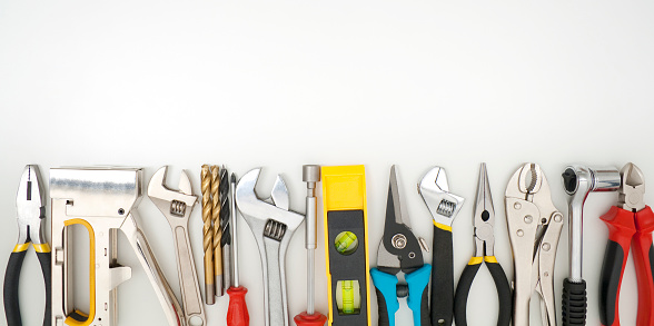 Work tools lined up on a white background 175438654