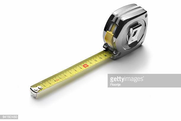 work tools: measure tape isolated on white background - meter unit of length stock photos and pictures