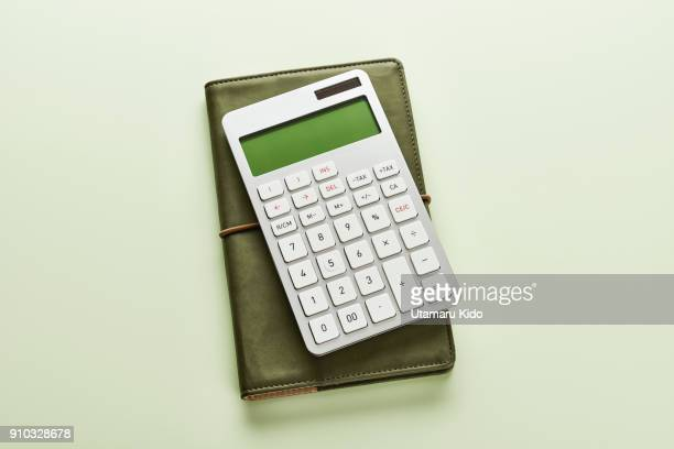 work tools. - calculator stock photos and pictures