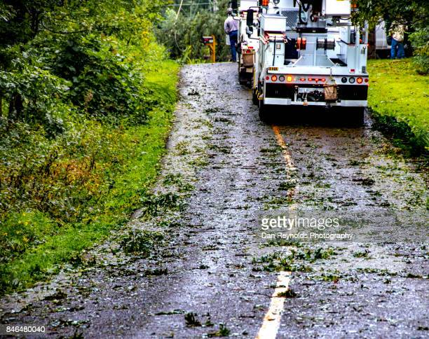 Work truck out for repair after storm on wet road