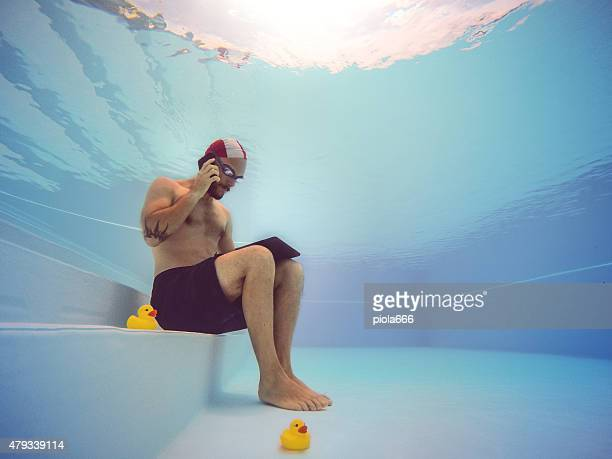 Workaholic man underwater