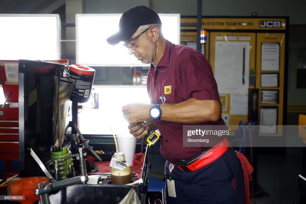 A worker adjusts a tool at a workstation at the JC Bamford Excavators LTD. (JCB) manufacturing plant in Pooler, Georgia, U.S., on Friday, Aug. 11, 2017. The Federal Reserve is scheduled to release industrial production figures on August 17. Photographer: Luke Sharrett/Bloomberg via Getty Images
