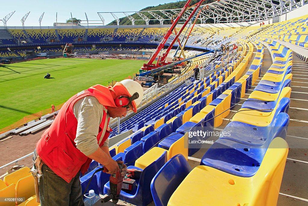 A worker adjusts new seats at Estadio Municipal de Concepción Alcaldesa Ester Roa Rebolledo is seen during restoration prior to Copa America Chile 2015 at Concepcion, Chile on April 17, 2015.