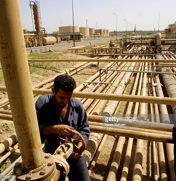 A worker adjusts the flow of an oil pipe at a refinery July 3 2001 in Kirkuk north of Baghdad Iraq Iraq agreed that it would seriously consider...
