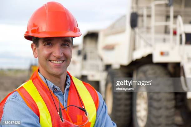 Worker and Big Dump Truck