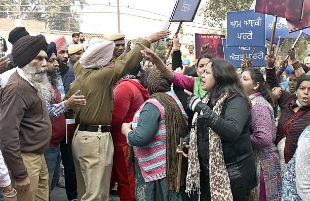 AAP worker and Police personnel forcefully removing the Agitating Mahila congress workers from the AAP party venue during the protest against Arvind..