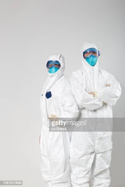 cdc worker and white background wall. - department of health and human services stock pictures, royalty-free photos & images