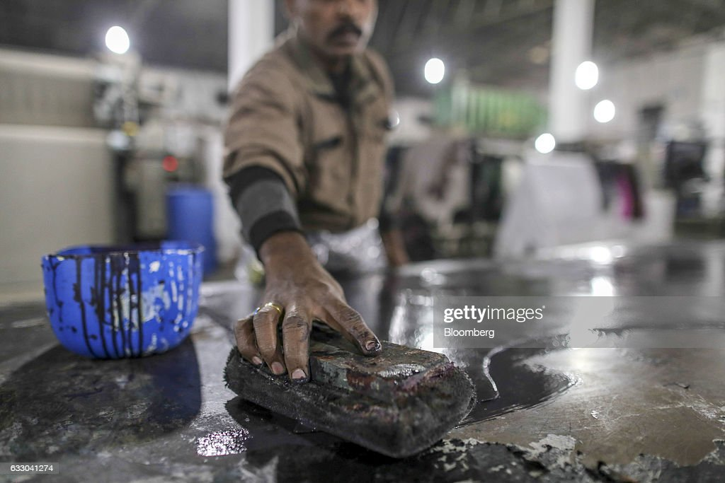 A worker applies dye to a piece of leather at the Jalandhar Leather Pvt tannery in Jalandhar Punjab India on Friday Jan 20 2017 India`s 51 million...
