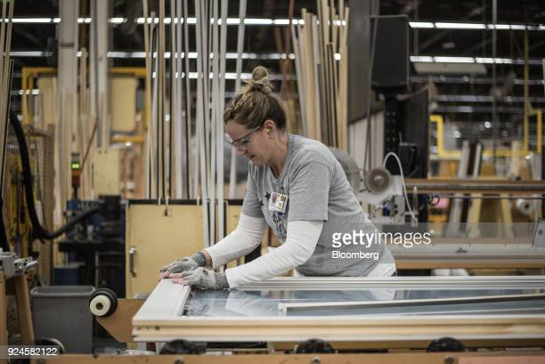 A worker applies sealant to a window frame at the Pella Corp manufacturing facility in Pella Iowa US on Thursday Feb 22 2018 The US Census Bureau is...