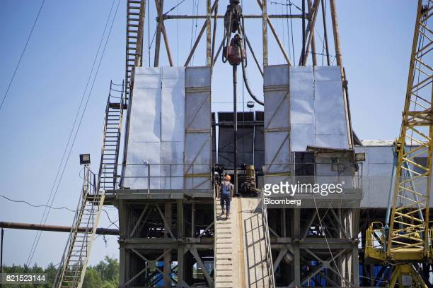 A worker approaches the drill floor of a drilling rig during gas extraction operations by DK Ukrgazvydobuvannya a unit of NAK Naftogaz Ukrainy in...