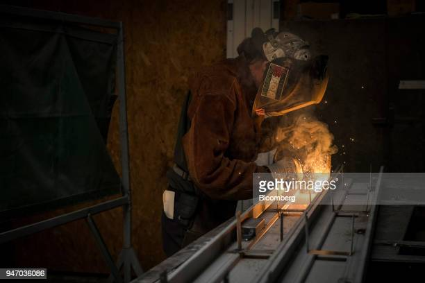 A worker arc welds a brace to a door at the Metal Manufacturing Co facility in Sacramento California US on Thursday April 12 2018 The Federal Reserve...