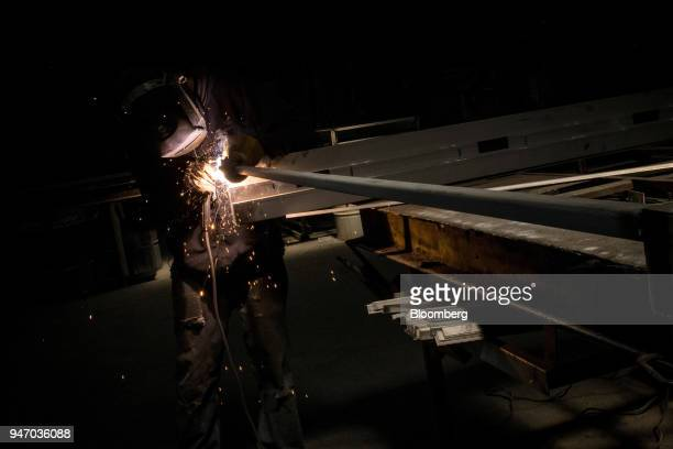 A worker arc welds a door during production at the Metal Manufacturing Co facility in Sacramento California US on Thursday April 12 2018 The Federal...