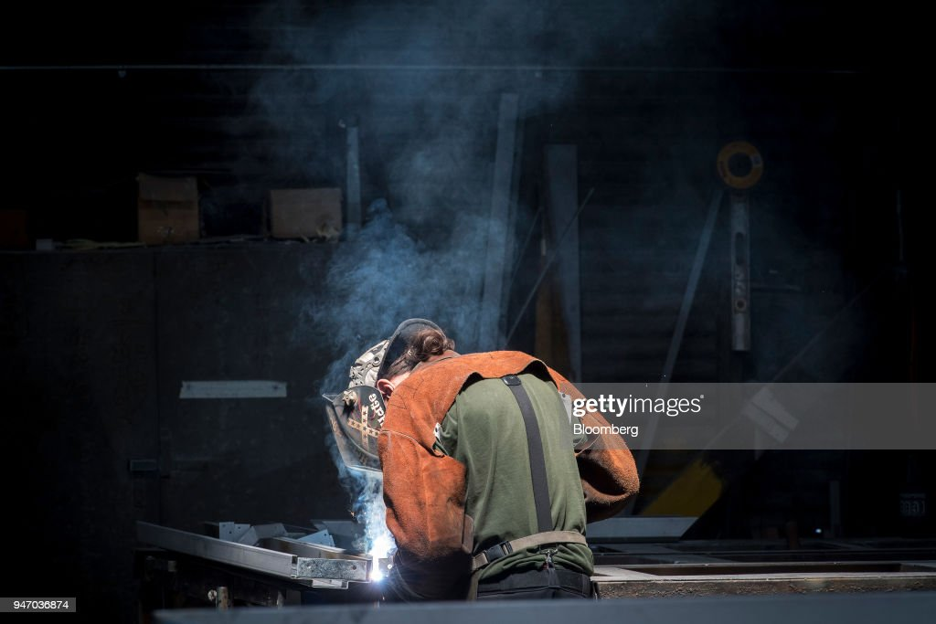A worker arc welds a metal door during production at the Metal Manufacturing Co. facility in Sacramento, California, U.S., on Thursday, April 12, 2018. The Federal Reserve is scheduled to release industrial production figures on April 17. Photographer: David Paul Morris/Bloomberg via Getty Images