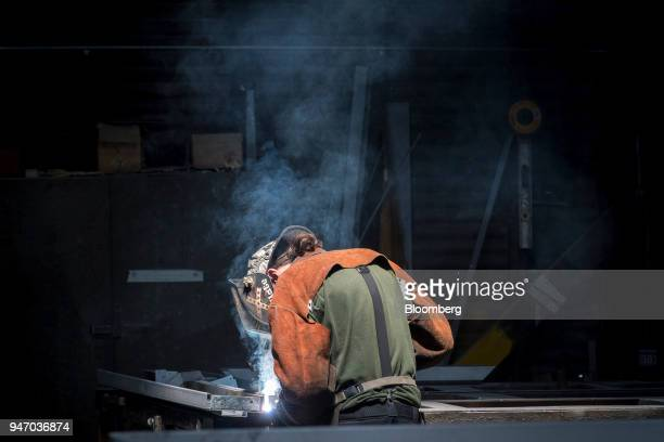 A worker arc welds a metal door during production at the Metal Manufacturing Co facility in Sacramento California US on Thursday April 12 2018 The...