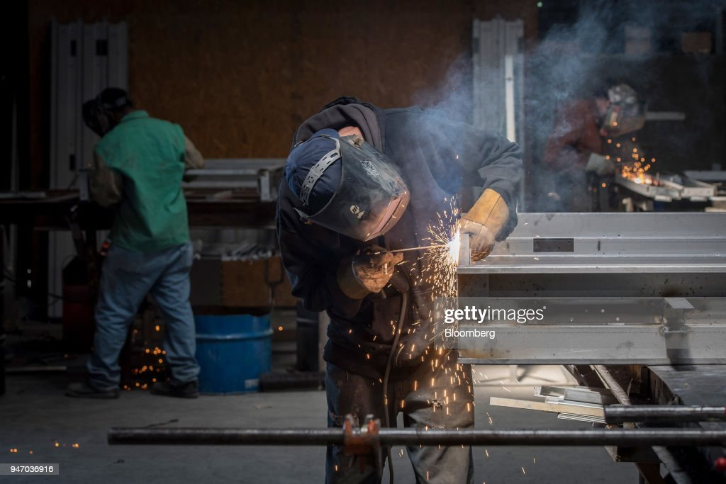 A worker arc welds seams on a metal door at the Metal Manufacturing Co. facility in Sacramento, California, U.S., on Thursday, April 12, 2018. The Federal Reserve is scheduled to release industrial production figures on April 17. Photographer: David Paul Morris/Bloomberg via Getty Images